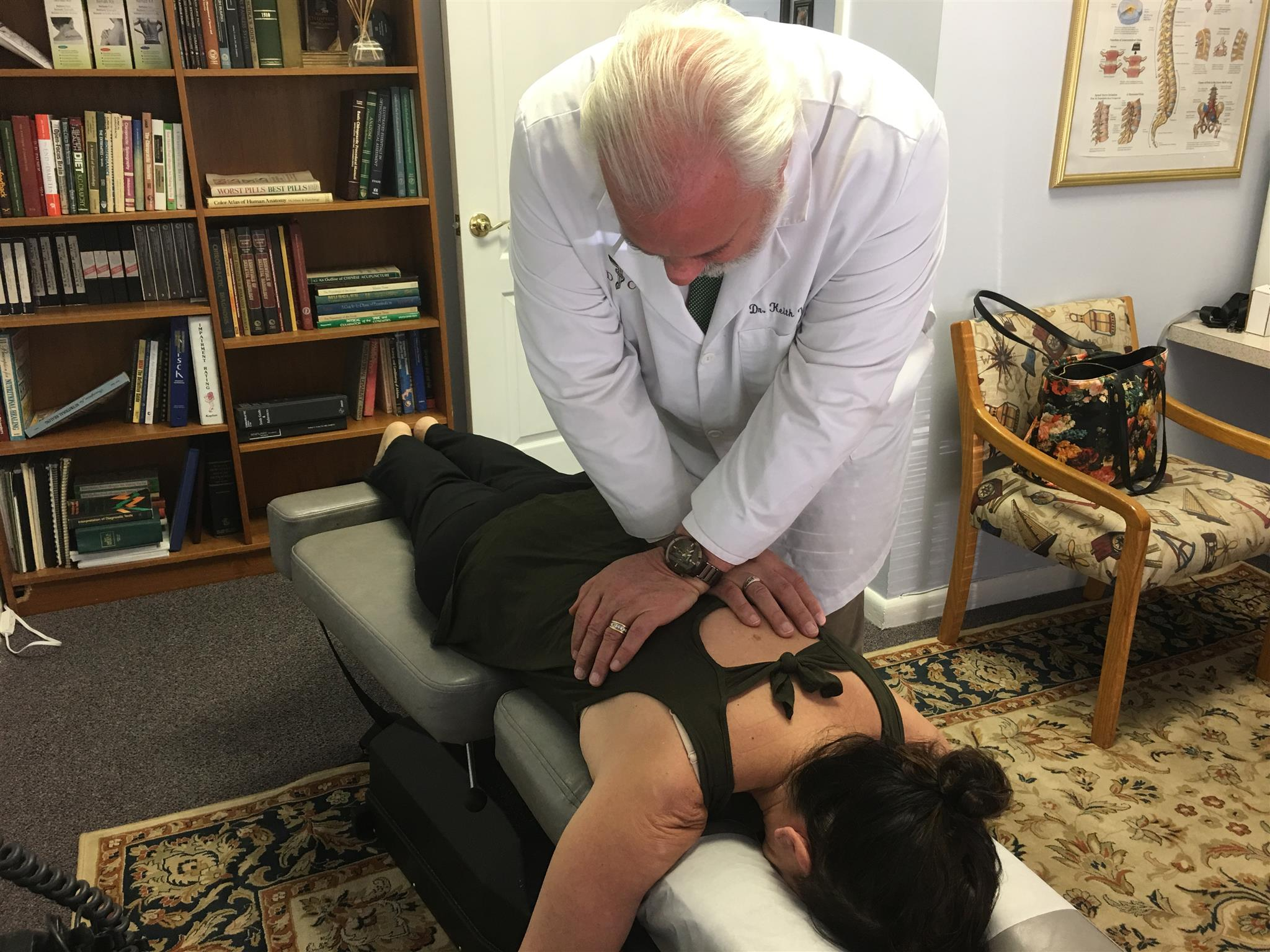 Dr. Keith Volstad performing a chiropractic adjustment at Volstad Chiropractic a Jupiter Florida 33458 chiropractor